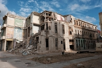 Abandoned building sits crumbling just next to The Malecon in Havana Cuba
