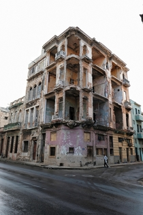 Abandoned building sits weathering on a corner in Havana Cuba