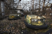 Abandoned bumper cars near the Chernobyl nuclear power plant Ukraine  by Ano Neemus