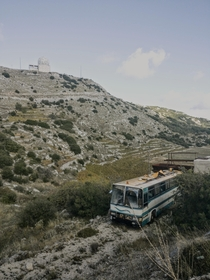 Abandoned bus in Greece watched over by a NATO radar facility