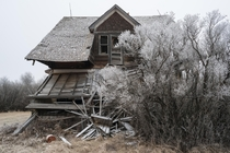 Abandoned Canadian farmhouse with frost