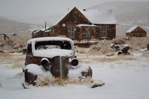 Abandoned car covered with snow at Bodie - ghost town at Mono CA US  photographed by David Goulart
