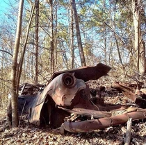Abandoned car left in the middle of the woods
