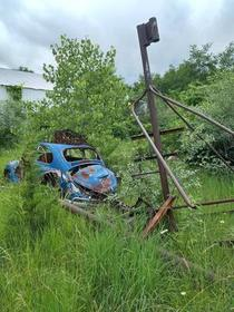 Abandoned car outside of a shack in rural MO