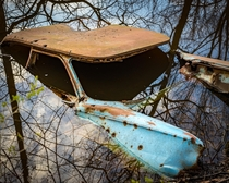Abandoned car partially submerged in water I stubbed across in my travels at a nature park