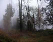 Abandoned chapel in a foggy cemetery Anonymous Photographer