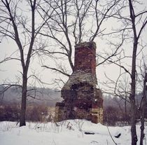 Abandoned chimney during a snowstorm Pennsylvania