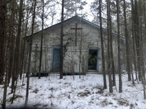 Abandoned church in rural Mississippi on land that was reclaimed by the government You couldnt see it through the pines until it snowed