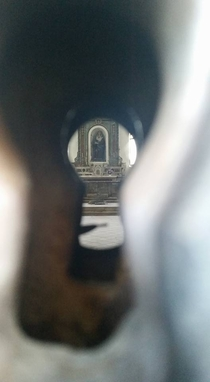 Abandoned church in Trevico Italy as seen through the keyhole of the front doors