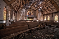 Abandoned church really on its last legs mushrooms growing out of the floor and a ceiling ready to impale the next guest