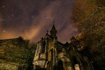 Abandoned church under the night sky in Belgium