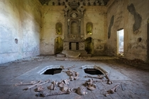 Abandoned church with bones displayed from crypt below