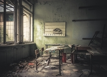 Abandoned class room with school books still on the desk