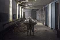 Abandoned communal bathroom in an abandoned seminary  by Andre Govia
