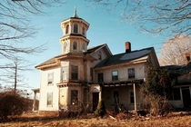 Abandoned Connecticut house with yellow tower