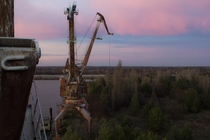 Abandoned cranes along the Pripyat River Chernobyl Exclusion Zone Ukraine