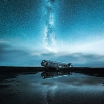 Abandoned Debris of a plane underneath a starry sky