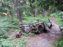Abandoned decayed car in woods of Helsinki Finland