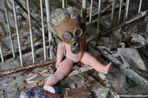 Abandoned doll with a gas mask at a kindergarten in Pripyat  Chernobyl  More in the comments