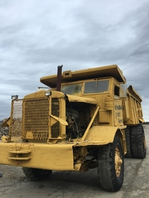 Abandoned dump truck at failed storage complex