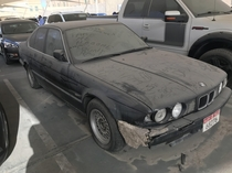 Abandoned E BMW  Series sitting in mall rooftop car park Dubai