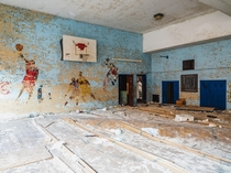 Abandoned Elementary Gym with a Basketball Mural