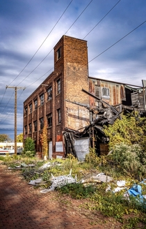 Abandoned factory on an old brick street in Toledo Ohio