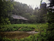 Abandoned Farm house by a creek Photo by Jennifer Wolfe