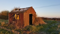 Abandoned farmers shack in todays frosty sunrise Cambridgeshire England