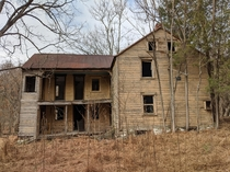 Abandoned farmhouse on national park property near Dargan Maryland and Harpers Ferry West Virginia Right side is original and framed with stacked hewn logs left side is a balloon-framed addition