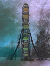 Abandoned Ferris wheel of the city of Pripyat during a blizzard