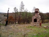 Abandoned fireplace on foundation remains of long-gone cabin just north of Lake Berryessa in Napa CA