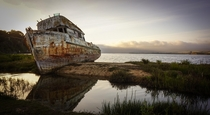 Abandoned fishing boat on a sanbar in Tomales Bay California