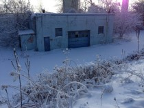 Abandoned Garage Hidden Behind Snow