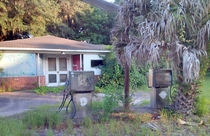 Abandoned Gas Station St Helena Island South Carolina August  note the Palmetto Palm growing in front of pump