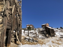 Abandoned gold mine Victor Colorado  taken from my phone Check out the moon right of the middle building
