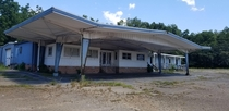 Abandoned Googie-style car dealership semi-rural NC USA