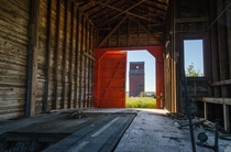 Abandoned grain elevator from inside another abandoned elevator