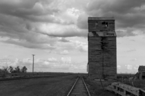 Abandoned grain elevator on railroad siding Comanche NE