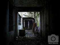 Abandoned hallway leading to the morgue at st josephs orphanage preston