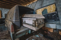 Abandoned hearse amp casket in an abandoned funeral home in Alabama