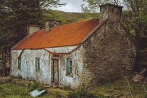 Abandoned hidden cottage on a hill Kerry Ireland