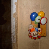 Abandoned home built in  Creepy clown has kept watch over the place