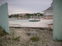 Abandoned Homesite Nassau Bahamas Someone cleans the pool and parties there