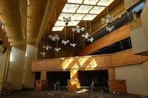 Abandoned hotel closed due to asbestos ceiling lights look like a bunch of flying drones
