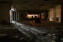 Abandoned hotel lobby at night