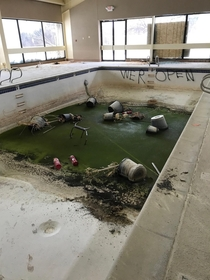 Abandoned hotel pool in Michigan taken last winter I was lucky the black sludge was frozen cant imagine the smell The place was demolished about a month ago but stood vacant for almost a decade