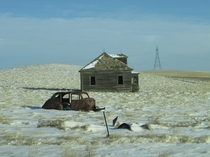 Abandoned house and  Ford riddled with bullets - somewhere west of Dunn Center ND