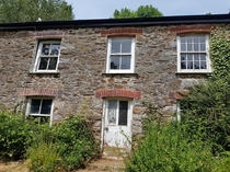 Abandoned house Cornwall UK All inside is completely gutted with bare crumbly stone walls