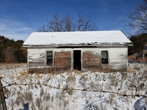 Abandoned house in the Sandhills of Nebraska tucked away deep in a cedar cut